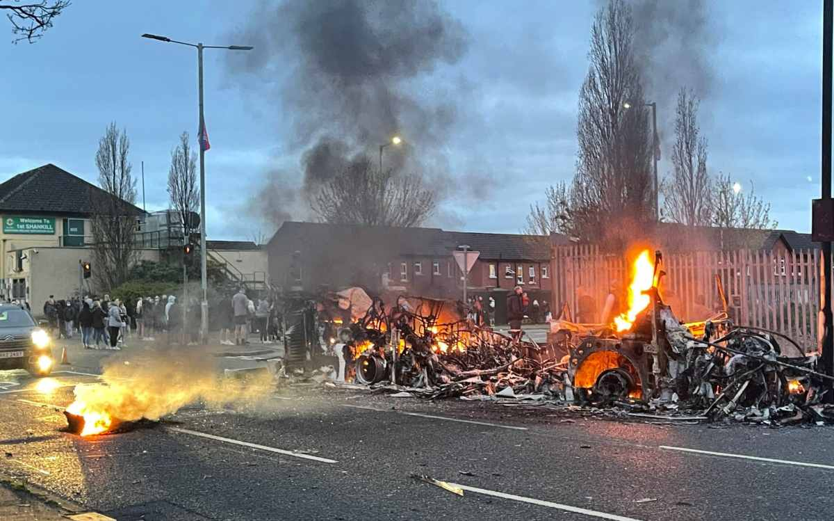 The wreckage of the burnt bus on Shankill Road