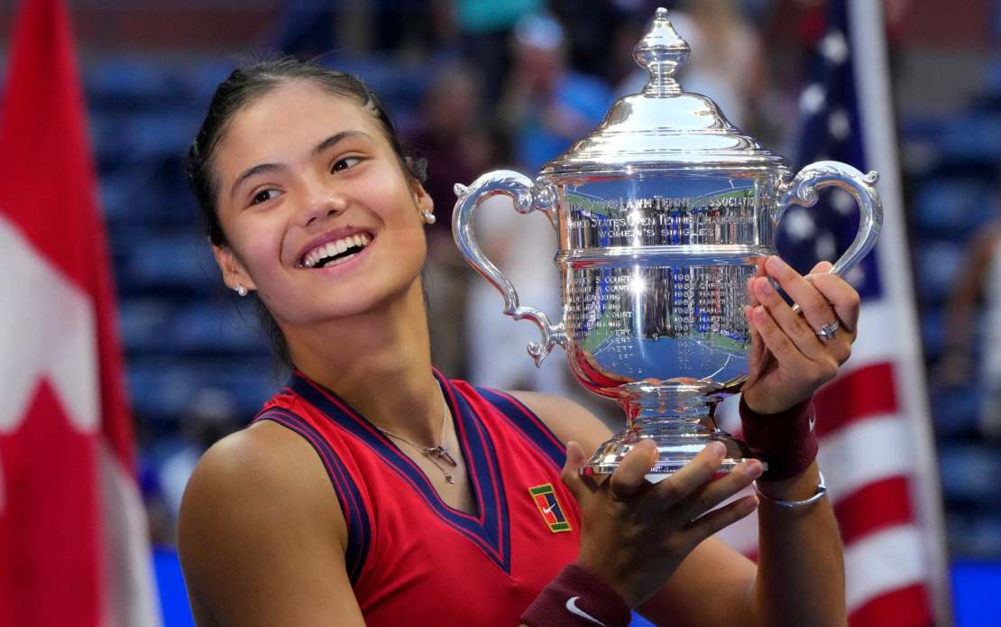 Emma Raducanu celebrates with the trophy after winning the 2021 US Open Tennis tournament women's final match against Canada's Leylah Fernandez