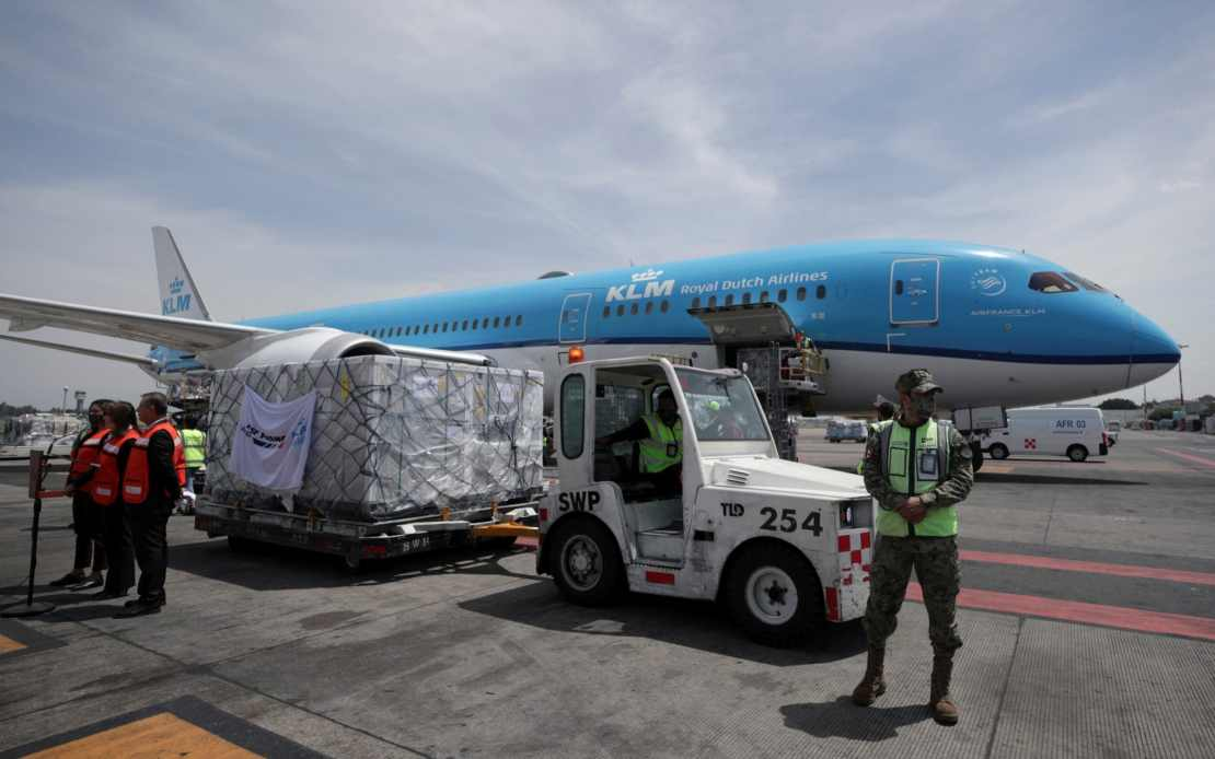 Workers in Mexico City unload a batch of AstraZeneca Covid vaccines delivered under the Covax scheme earlier this month
