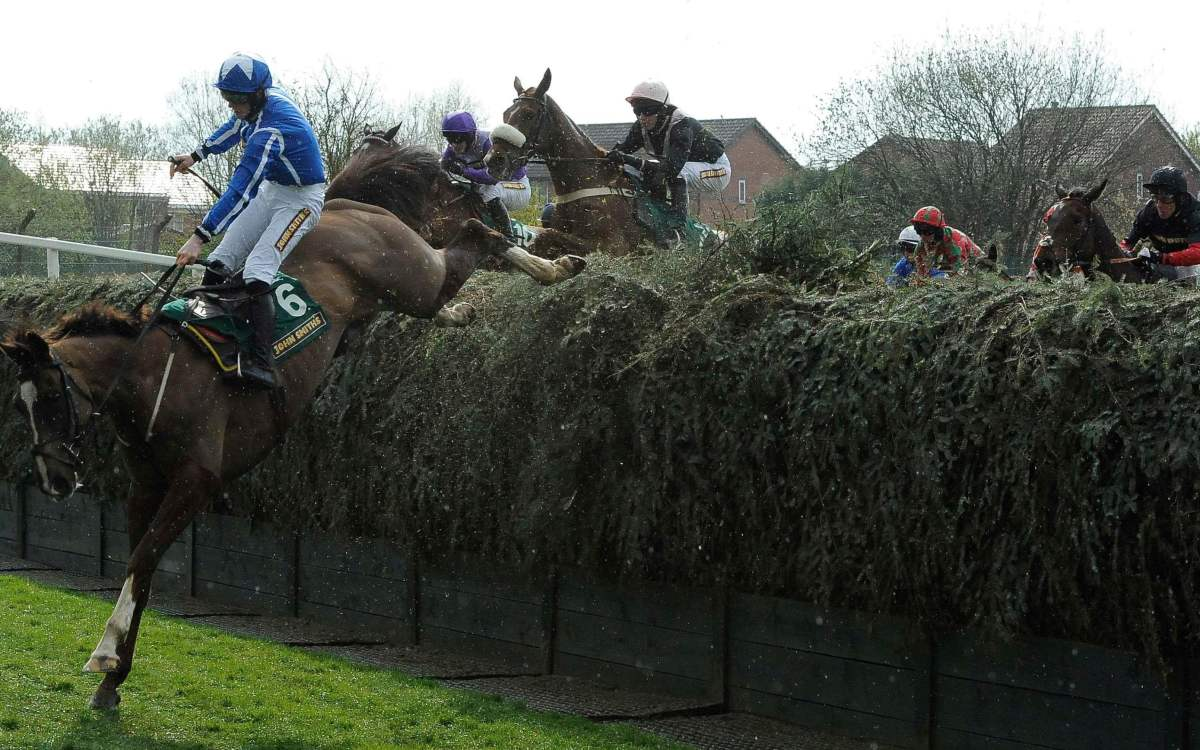 Sam Twiston-Davies jumps Beechers Brook during the John Smiths Topham steeple chase on the second day of the Grand National meeting at Aintree