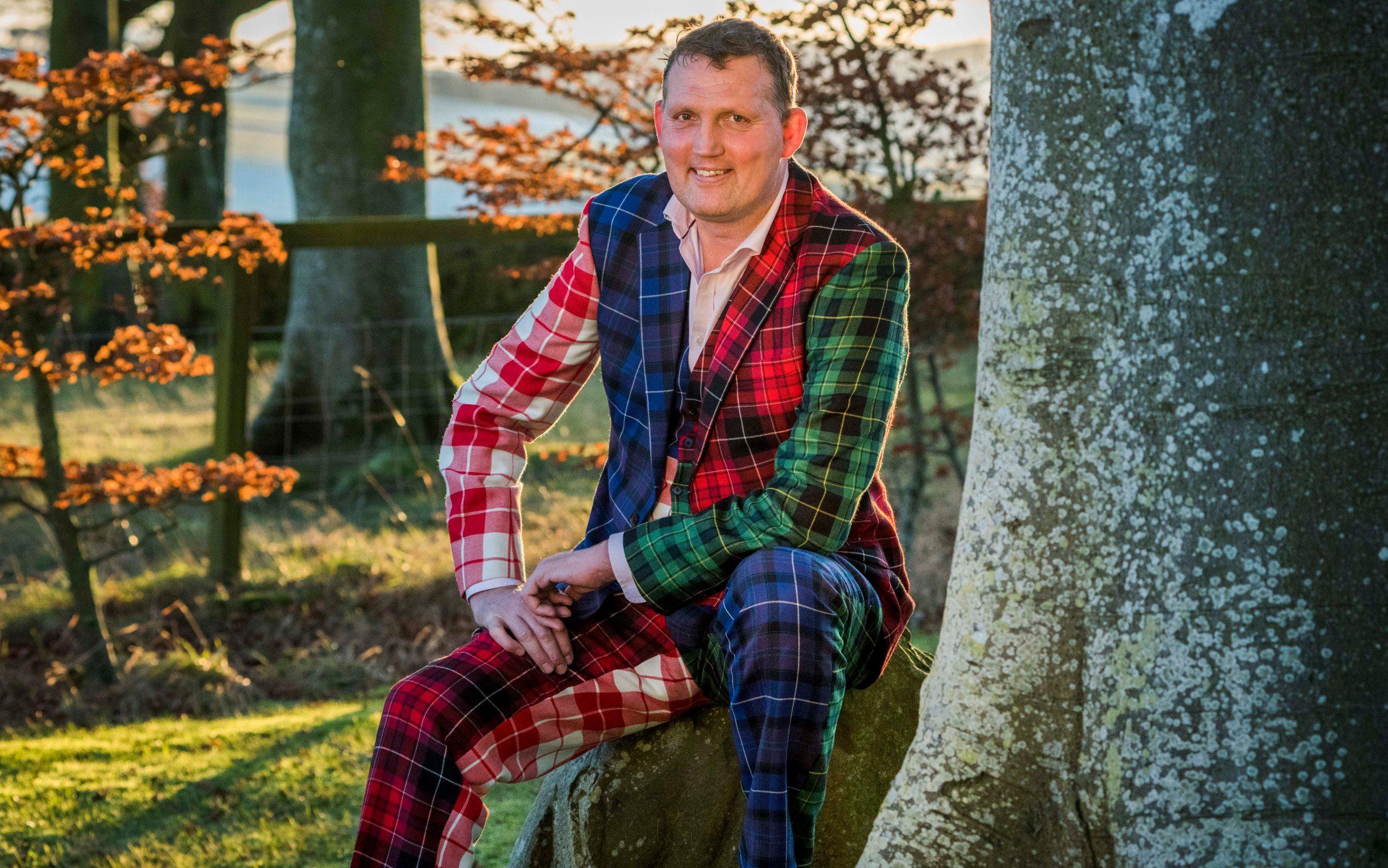 Doddie Weir in tartan suit