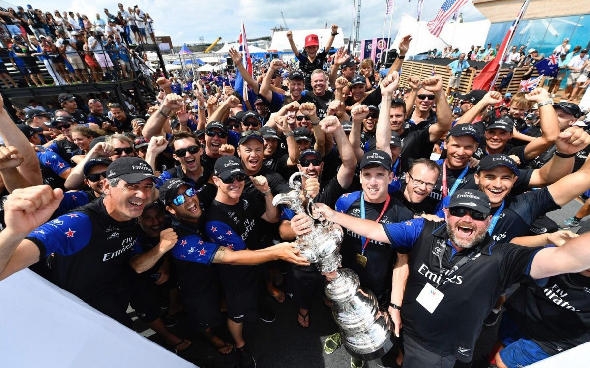 Emirates Team New Zealand celebrate winning the famous America's Cup trophy in 2017