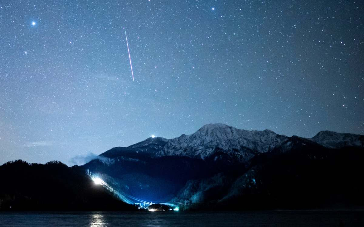The Geminid meteor stream above the Kochelsee and the summit of the Herzogstand early Monday, Dec. 14, 2020