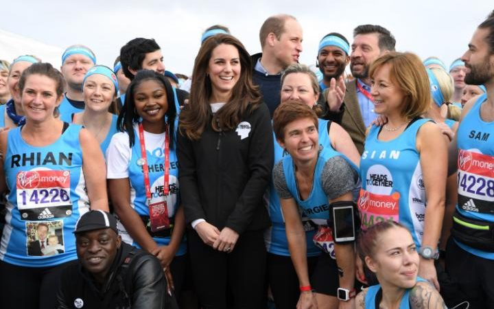 The Duke and Duchess of Cambridge greet runners ahead of the London Marathon 2017. The runners pictured are running on behalf of the Heads Together campaign.