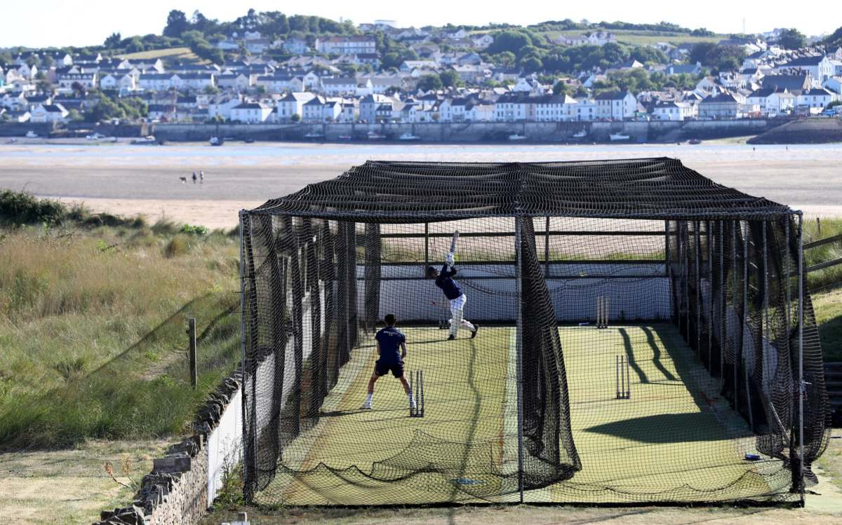 Jay Rothery of North Devon Cricket Club bats as Archie Popham bowls during a nets session carried out under new ECB guidelines on May 29, 2020 in Instow, England. The coronavirus and the disease it causes, COVID-19, are having a fundamental impact on society, government, sports and the economy in United Kingdom. As all sports events in United Kingdom have been cancelled athletes struggle to continue their training as usual