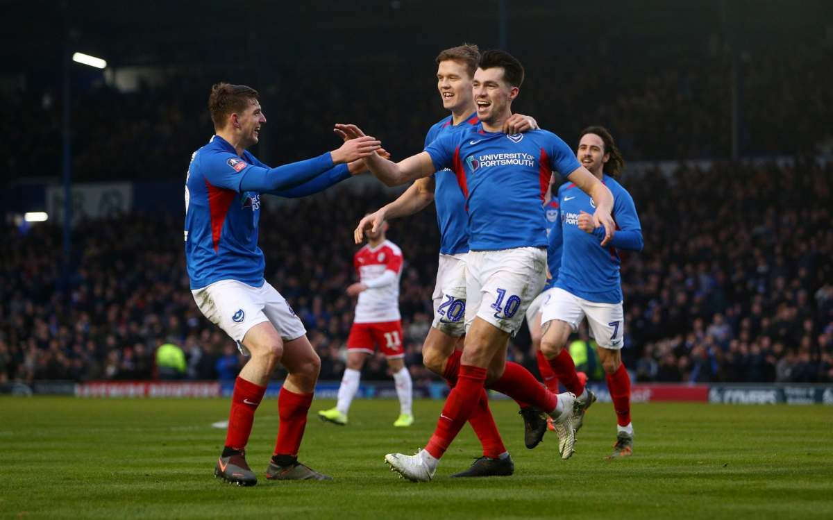John Marquis of Portsmouth FC celebrates with teammates after scoring his team's second goal during the FA Cup Fourth Round match between Portsmouth FC and Barnsley FC