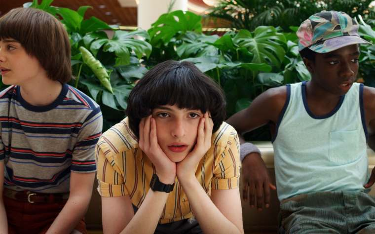 Finn Wolfhard as Mike (centre)