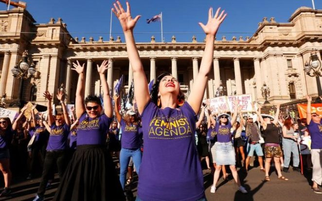 Thousands of demonstrators attend a rally for International Women's Day in Melbourne, Australia, calling for de-colonisation, an end to racism, economic and reproductive justice.