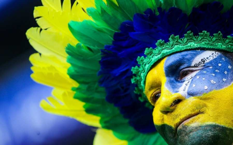 Brazil Football Team A Brazilian football fan has painted his face in national colours for his  team s 2018 FIFA