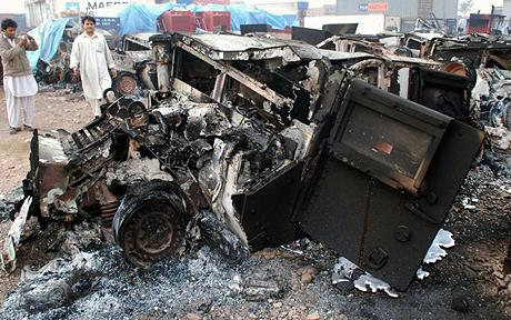 destroyed Humvees and military trucks at the Portward Logistic Terminal in Peshawar