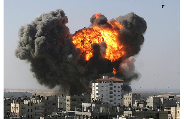 An explosion during Israeli air strike in the southern Gaza Strip town of Rafah near the border with Egypt...
