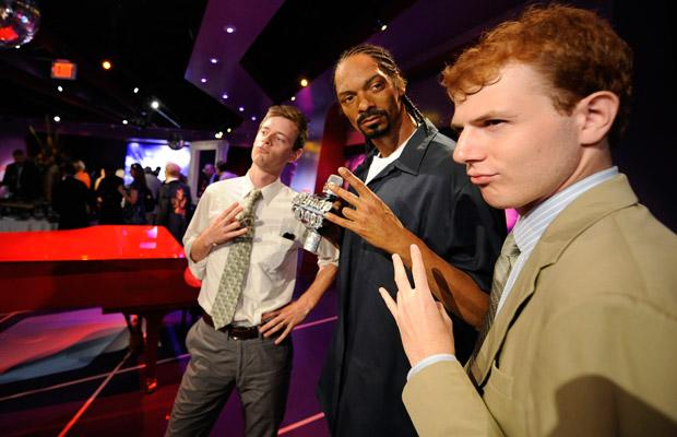 Jeremy Mann and Jake Petzlle pose with a waxwork of recording artist Snoop Dog at the opening of Madame Tussauds Hollywood