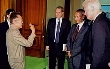 Former U.S. President Bill Clinton (R) meeting with North Korea's leader Kim Jong-il (L) in Pyongyang