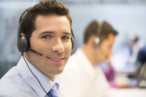 A man wears a headset at a live answering service