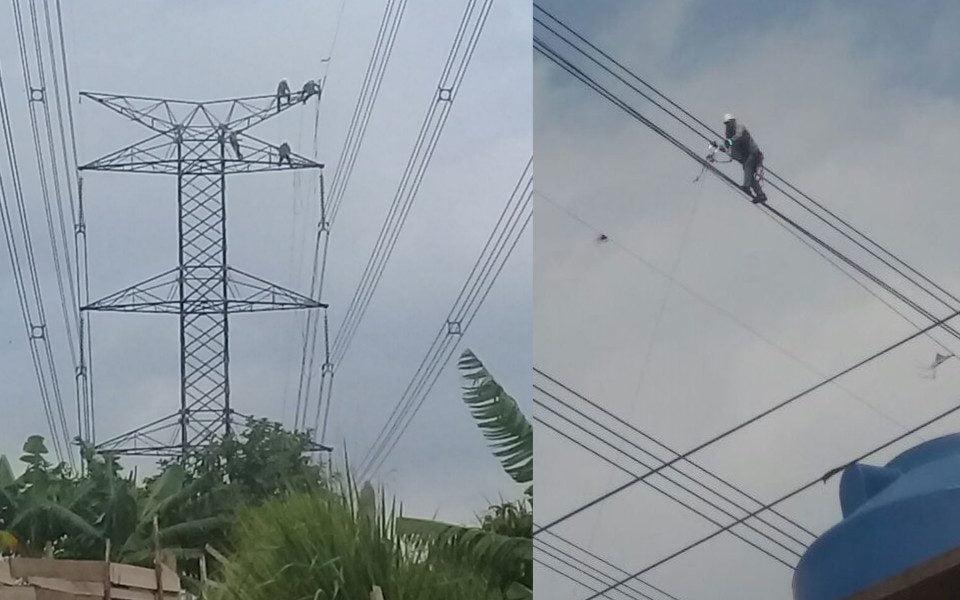 Nas fotos acima, a equipe de reparos de Furnas, responsável pelas torres, sobe no topo de uma delas para baixar o cabo que será reparado pelos técnicos da Eletronet. (Divulgação)