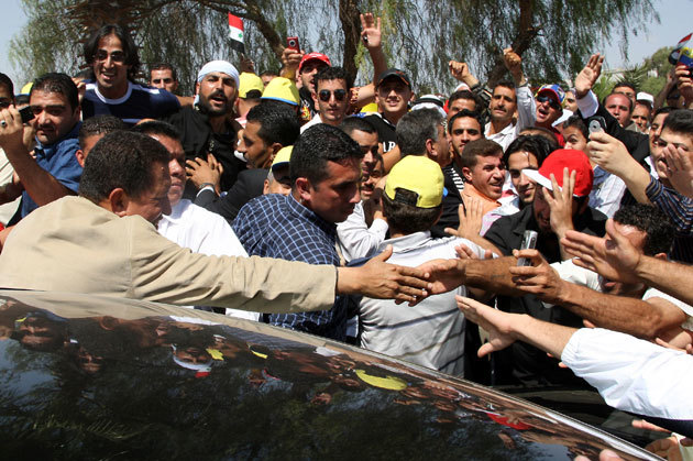 Hundreds greet President Chavez upon his arrival in Syria, 2009. The Venezuelan leader was widely regarded in the Arab world, particularly for his opposition to Israeli and U.S. atrocities in the region.