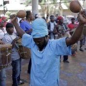 Members of the Garifuna organization OFRANEH demonstrate in front of the Honduran Parliament in Tegucigalpa.