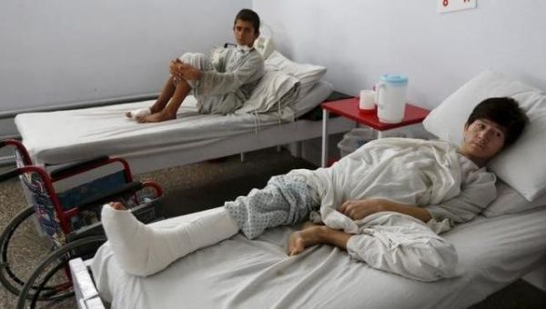Wounded Afghan boys, who survived a U.S. air strike on a Medecins Sans Frontieres (MSF) hospital in Kunduz, receive treatment.