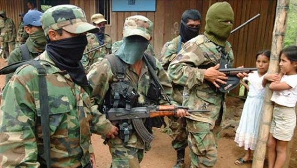 United Self-Defense Forces of Colombia (AUC) paramilitaries patrol a small village. The AUC have been responsible for torture, extrajudicial killings, war crimes and crimes against humanity.