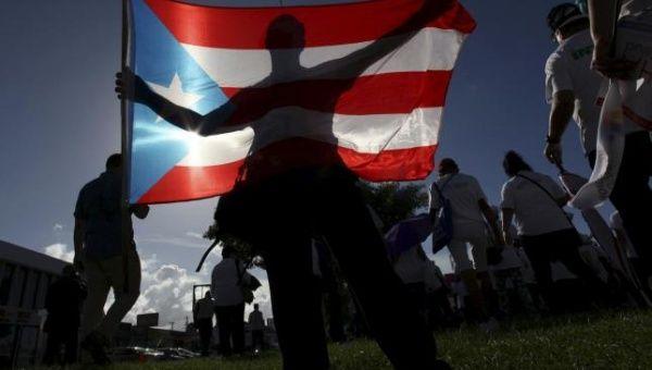 A protester holding a Puerto Rico