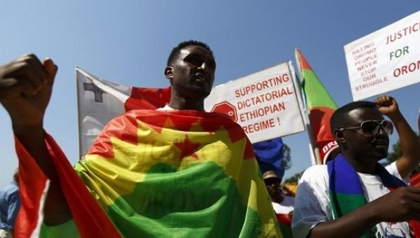 Ethiopian migrants of the Oromo community living in Malta protest against the Ethiopian regime, Valletta June 16, 2014.