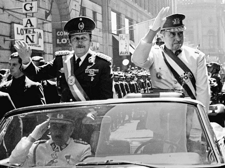 Paraguayan dictator General Alfredo Stroessner (L) and Chilean dictator Gen. Pinochet (R) wave to crowds in Santiago, Chile.