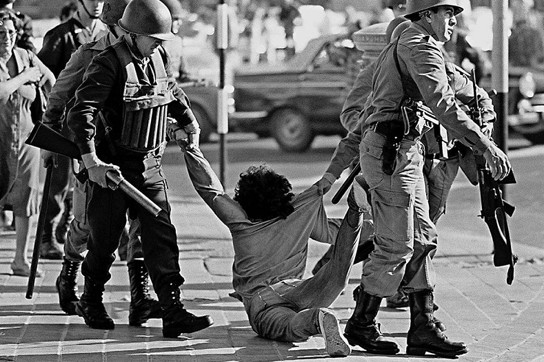 Worker being arrested during a protest against the Argentine dictatorship in Buenos Aires, March 30, 1982
