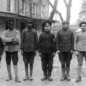 A group of captured Allied soldiers of eight nationalities: Vietnamese, Tunisian, Senegalese, Sudanese, Russian, American, Portuguese, and English.