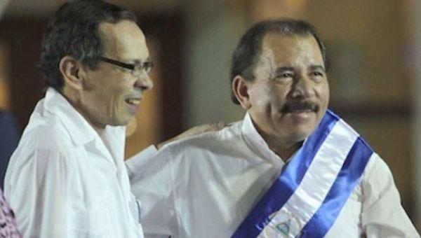 Rene Nuñez Tellez (L) next to Nicaraguan President Daniel Ortega