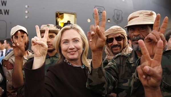 Secretary of State Hillary Clinton with Libyan soldiers upon her departure from Tripoli in Libya on October 18, 2011.