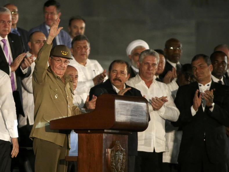Cuban President Raul Castro acknowledges the applause as he attends a massive tribute to his brother, the late President Fidel Castro.