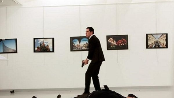 Russian Ambassador to Turkey Andrei Karlov lies on the ground after he was shot by Mevlut Mert Altintas at an art gallery in Ankara, Turkey, December 19, 2016.