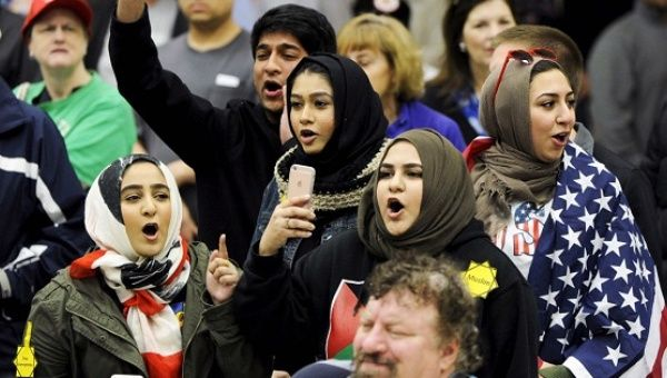 Young Muslim women protesting outside a Donald Trump campaign rally Wichita, Kansas March 5, 2016.