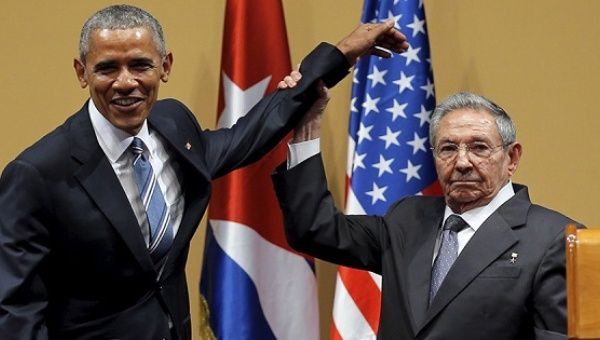 Cuban President Raul Castro leaves former U.S. President Barack Obama hanging as he went in for a hug.