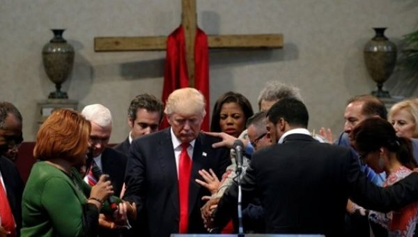 Clergy lay hands and pray over Donald Trump at the New Spirit Revival Center in Cleveland Heights, Ohio, Sept. 21, 2016.