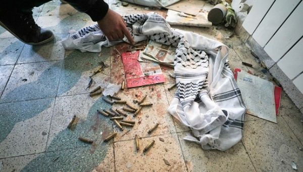 A man inspects the scene where a Palestinian was killed by Israeli forces during a clash in the West Bank city of Ramallah.
