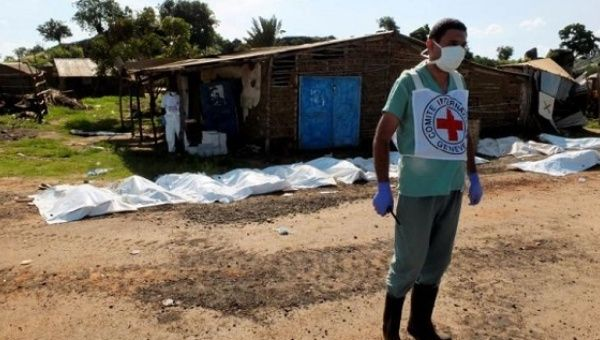 A worker from the International Committee of the Red Cross prepares to move bags containing bodies of unidentified people killed in the recent fighting in checkpoint area of Juba, South Sudan.