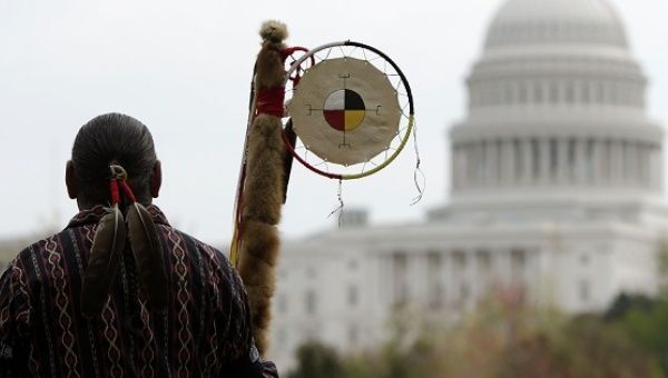 Matthew Black Eagle Man of the Sioux Long Plains First Nation protests in front of the U.S. Capitol, against the Keystone XL pipeline in April 2014.