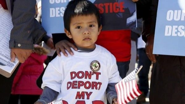 A young boy at an immigration rights rally in 2015.