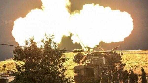An Israeli artillery gun fires a shell into Lebanon, Jan. 4, 2016.