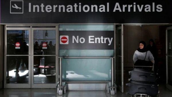 An international traveler arrives after U.S. President Donald Trump
