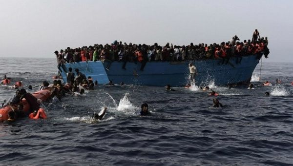 Refugees stranded off the coast of Libya swim for a rescue ship. Oct. 2016.