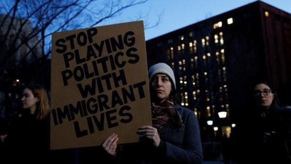Danielle Frank holds a sign as demonstrators gather at Washington Square Park to protest against U.S. President Donald Trump in New York, U.S., Jan. 25, 2017.