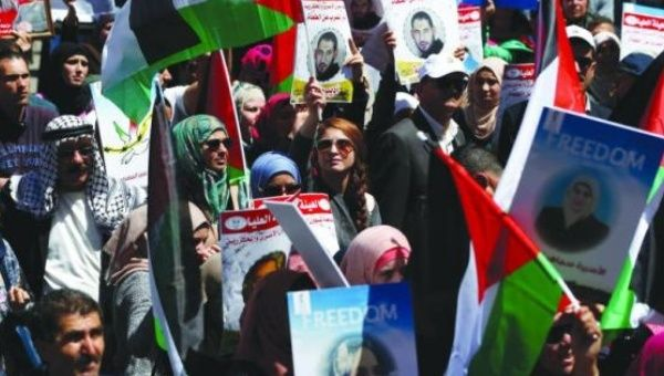 Protesters attend a rally marking Palestinian Prisoners