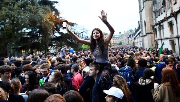 Revellers attend May Day celebrations outside Magdalen College as the sun rises over Oxford, Britain, May 1, 2017.