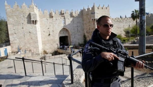 An Israeli policeman stands guard near Damascus Gate in Jerusalem