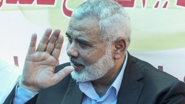 Hamas chief, Ismail Haniyeh, gestures as he meets with protesters at a sit-in supporting Palestinian hunger-striking prisoners held in Israeli jails, in Gaza City, May 8.