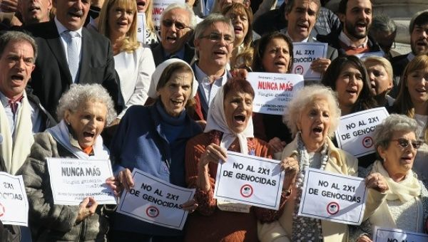 "Members of human rights organizations outside Congress in Buenos Aires to celebrate a sanction against the so-called ""two for one"" bill."