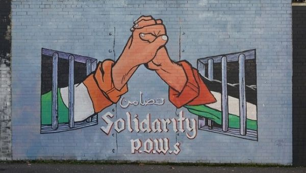 A mural depicting Irish-Palestinian solidarity in Belfast, Ireland
