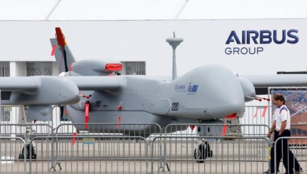"Visitors walk past a surveillance unmanned air vehicle ""Heron TP"" by IAI and Airbus Defence at the ILA Berlin Air Show in Schoenefeld, south of Berlin, Germany, May 31, 2016."